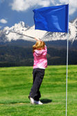 Cute little girl playing golf — Stock Photo