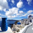 Santorini island with church and blue vase in Greece — Stock Photo #17332295
