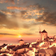 Windmill against colorful sunset, Santorini, Greece - Stock Photo