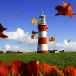 Stock Photo: Plymouth Lighthouse with autumn leaves in England