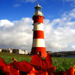 Plymouth Lighthouse with autumn leaves in England — Stock Photo #17373439
