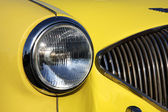 Detail of the yellow old car — Foto Stock