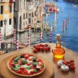 Classic Italian pizza in Venice against canal, Italy — Stock Photo