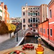 Stock Photo: Classic Italian pizza in Venice against canal, Italy