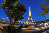 Eiffel Tower with boat in Paris, France — Stockfoto