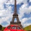 Eiffel Tower with red old car in Paris, France — Stock Photo #47715589