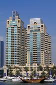 Dubai Marina with boat against skyscrapers in Dubai, United Arab Emirates — Stock Photo