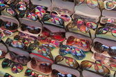 Colourful umbrella reflected in sunglasses at street market. Yangon. Myanmar. — Stock Photo
