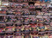 Colourful umbrella reflected in sunglasses on street market. Yangon. Myanmar. — Stock Photo