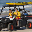 Two beach lifesavers in a surf patrol cart. Fingal Bay. Port Ste — Stock Photo #39700569