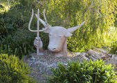 Sculpture of Zeus-bull with trident in his hand. Bingie. Nsw. Australia. — Stock Photo