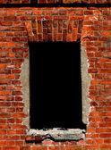 Een venster op een bakstenen muur — Stockfoto