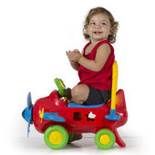 Baby girl and airplane toy — Stock Photo