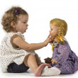 Baby girl playing with her doll — Stock Photo