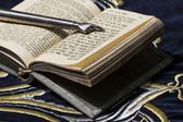 Open bible book in Hebrew with silver pointing hand stick — Stock Photo