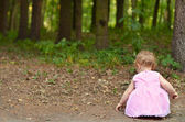 Baby girl in the forest — Stock Photo