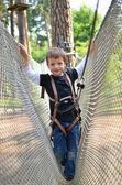 Brave little boy in adventure park — Stock Photo