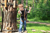 Happy boy in rope park — Stock Photo