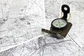 Compass on the background maps — Stock Photo