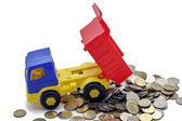 Toy truck transports coins — Stock Photo