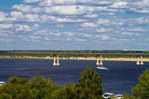 """Dancing"" bridge over the Volga river. — Stock Photo"