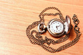 Pocket watch chain on the background of a wooden Desk — Zdjęcie stockowe