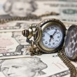Stock Photo: Pocket watch lie on dollars