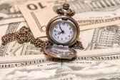Pocket watch lie on dollars — Stock Photo