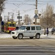 Постер, плакат: :at the crossroads in the snow covered city Tram stop street of Marshal Rokossovsky