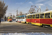Trams run to meet each other. The city comes alive after an abnormal snowfall — Stock Photo