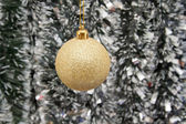 The Golden ball against the background of new year's tinsel — Stock Photo