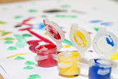 Multicolored jars with gouache and a children's drawing — Stockfoto