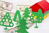 Toy trees , monetary alley in front of a small house — Stock Photo