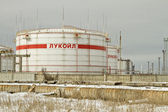 Storage of light petroleum products on the territory of the refinery, with the inscription LUKOIL — Stock Photo