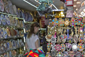 Huge selection of beautiful and affordable Souvenirs for tourists on the shelves of street shops — Stock Photo