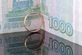 Golden wedding ring on the background of banknotes thousand rubles — Stock Photo
