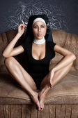 Sexy impudent nun — Stock Photo