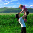 Постер, плакат: Mother and daughter in the field
