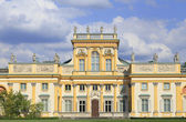 Facade of the Palace in Wilanow district in Warsaw, Poland. Wilanów Palace was built for king John III Sobieski in the last quarter of the 17th century and later was enlarged by other owners — Stock Photo