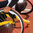 Wheelchair sportsmen at race track — Stock Photo