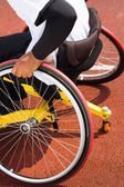 Wheelchair sportsmen at race track — Stock Photo