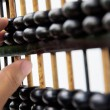 Stock Photo: Hand hold abacus