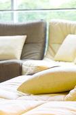 Soft cushion in sofa — Stock Photo