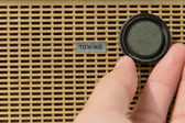 Hand with tuner radio knob — Stock Photo