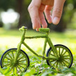 Hand Holding green bicycle — Stock Photo