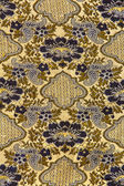 Close up of retro tapestry fabric pattern background — Stock fotografie