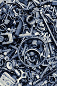 Assorted old screws background — Stock Photo