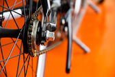 Low-down Shot of Bicycle Wheels and gearwheel — Stock Photo