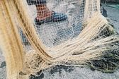 Fisherman pulling in his Fishing Net — Stock Photo