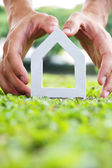 Hand halten Symbol Haus — Stockfoto